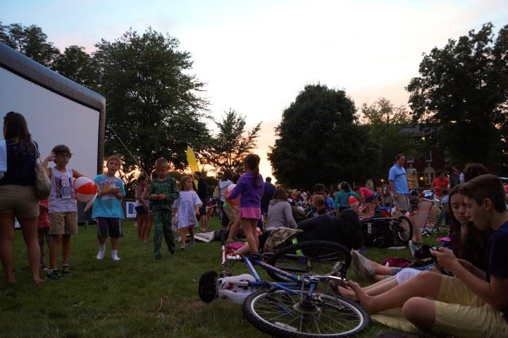 Movie-goers enjoy another movie night on the Village Green