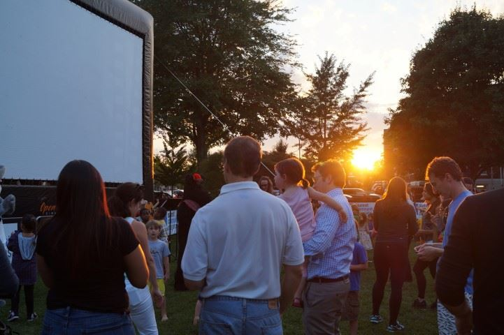 The sun sets over another movie night on the Green
